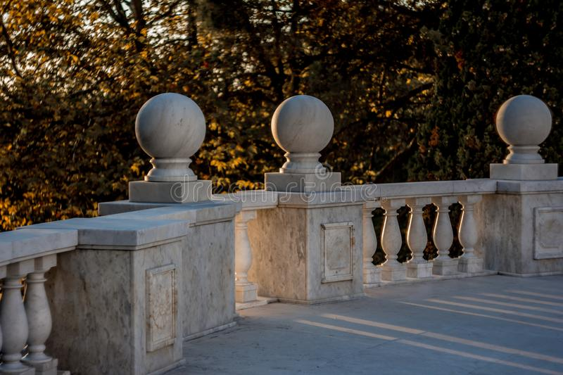 The splendor of marble. Marble staircase. Marble railing. Marble on sunset background. refinement. greatness.  A great example of architecture. Nature and stock photo