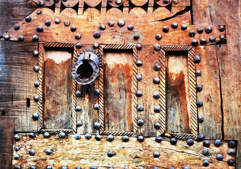 The Splendor Of Old Doors And Windows. Beautiful Moroccan old doors and windows. Marrakesh, Morocco. In the old medina of Marrakesh city, doors and windows royalty free stock images