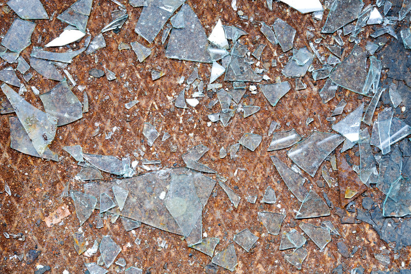 Splinters of glass. The rusty old metal floor and splinters of glass royalty free stock photos