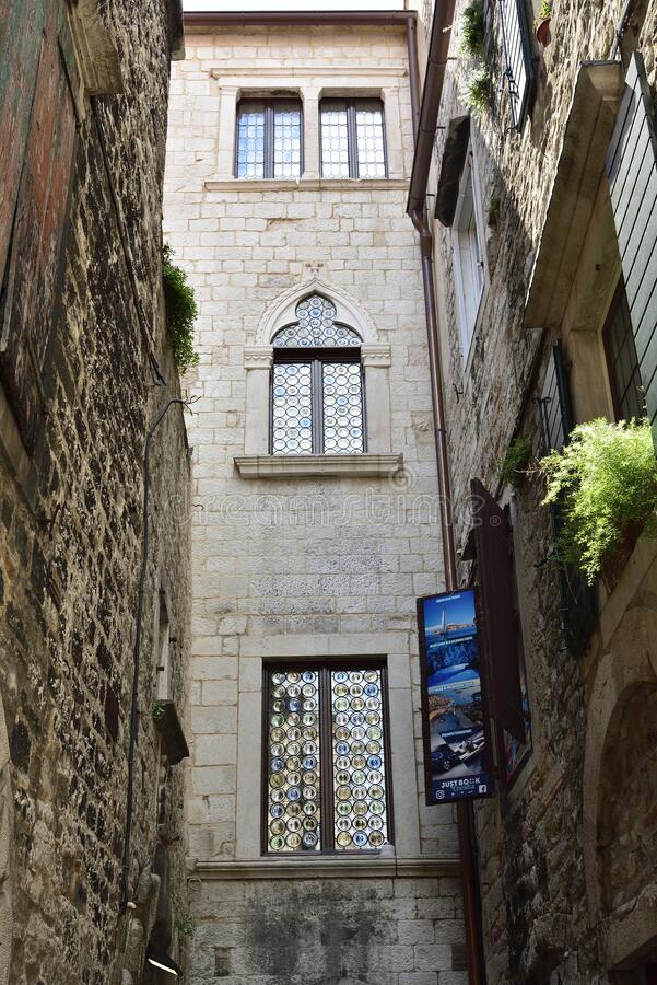 SPLIT, CROATIA - APRIL 29, 2019: Ancient buildings surrounding the Diocletian`s Palace in Split city center at the sunny day in. SPLIT, CROATIA - APRIL 29 stock photo