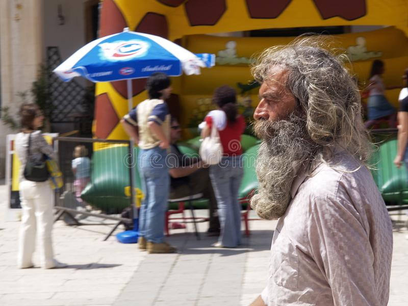An old gray long-haired bearded man stock images