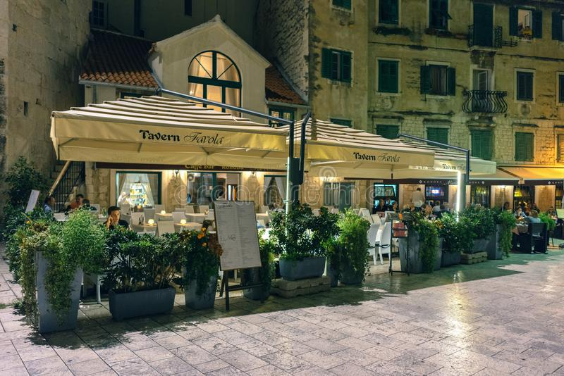 Split, Croatia. Cafe in the old town. SPLIT, CROATIA - 23 SEPTEMBER, 2015: Old Town Area, outdoor café in the evening stock images