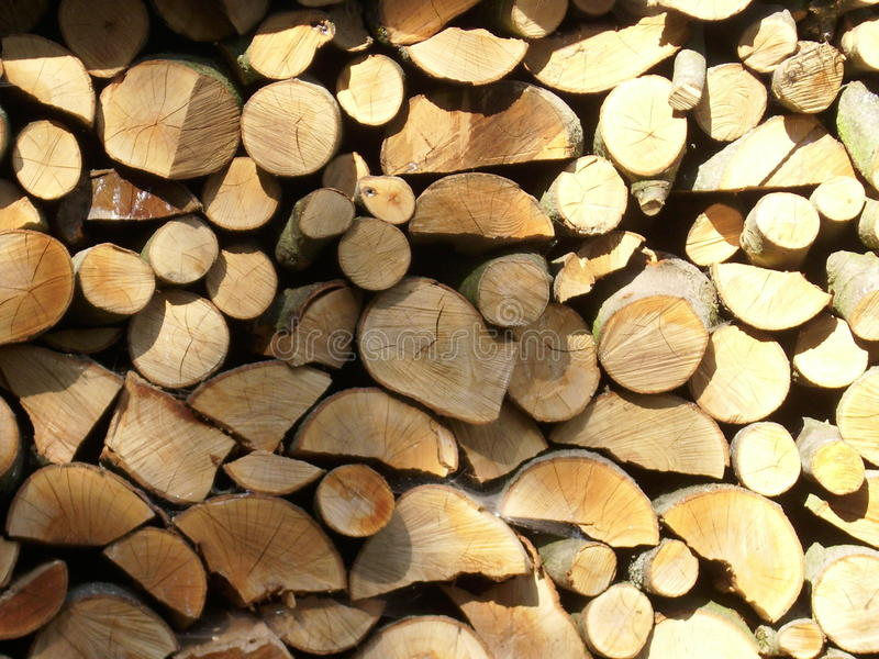 Firewood log stack. Coppiced and split logs drying and making an attractive collage of interlocked cut log ends. Could be used as a background texture stock images