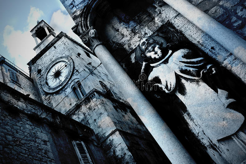 Download Split - Old Clock Tower And Saint Sculpture Royalty Free Stock Image - Image: 15061916