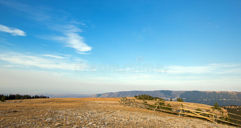 Split rail fence on ridge in early morning light above Lost Water Canyon in the Pryor Mountains Wild Horse Range in Wyoming. USA royalty free stock image