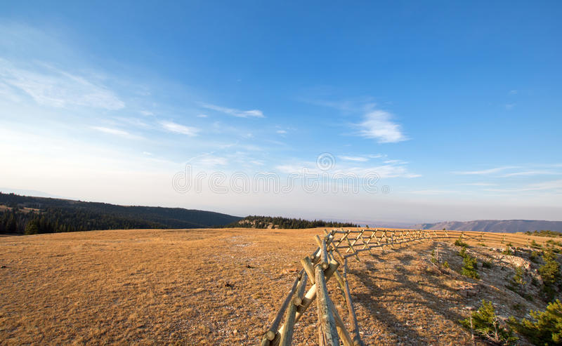 Split Rail Fence at sunrise above Lost Water Canyon in the Pryor Mountains Wild Horse range in Montana USA. Split Rail Fence at sunrise above Lost Water Canyon royalty free stock photography