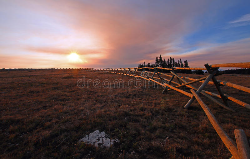 Split Rail Fence at sunrise above Lost Water Canyon in the Pryor Mountains Wild Horse range on the Montana Wyoming state line. USA stock images