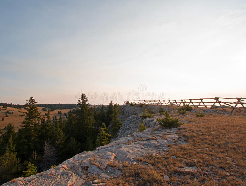 Split Rail Fence at sunrise above Lost Water Canyon in the Pryor Mountains Wild Horse range on the Wyoming state line. Split Rail Fence at sunrise above Lost royalty free stock photography