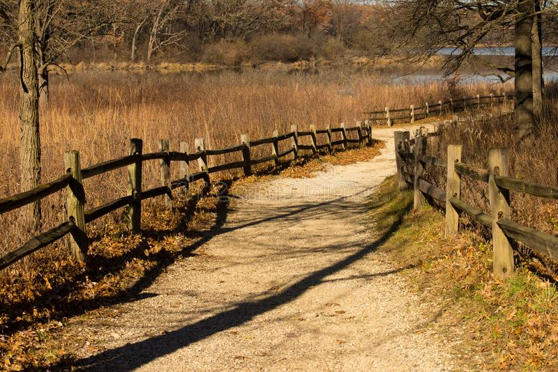Split rail lined Gravel path at the Little Red Schoolhouse Nature Center royalty free stock photos