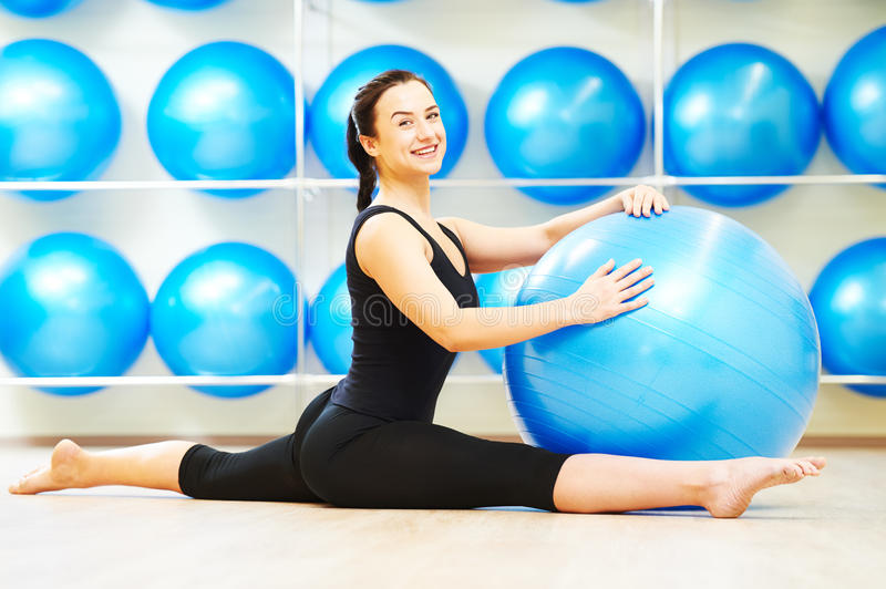 Split stretching exercises with fitness ball royalty free stock photo
