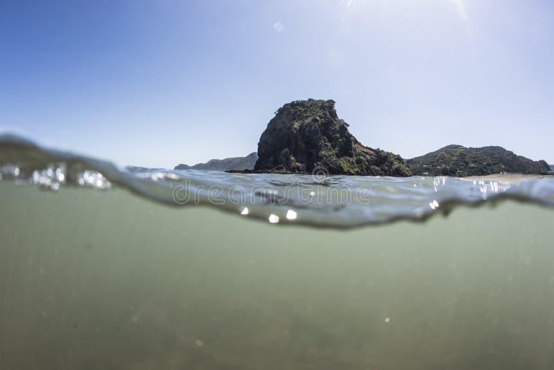 Split View of Lion Rock Piha Beach royalty free stock photos
