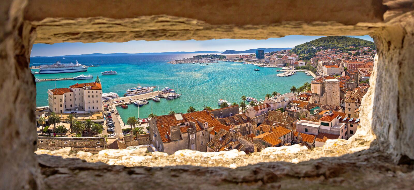 Split waterfront aerial panoramic view through stone window. Dalmatia region of Croatia royalty free stock photo