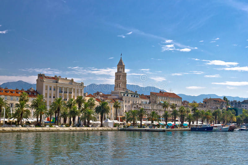Split waterfront palm promenade view. Split waterfront palm promenade and Diocletian Palace view, Dalmatia, Croatia royalty free stock photo