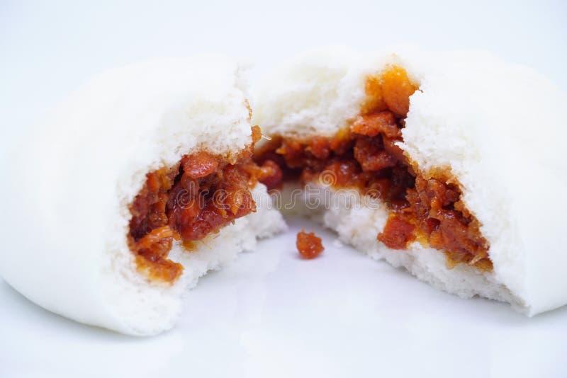 A splited roast red pork chinese bun royalty free stock photo