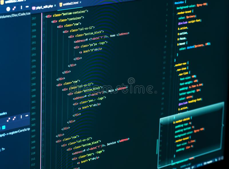 Splitting of html and css in the code editor on the monitor, close up. Web Design and Web development. Splitting of html and css in the code editor on the royalty free stock photos
