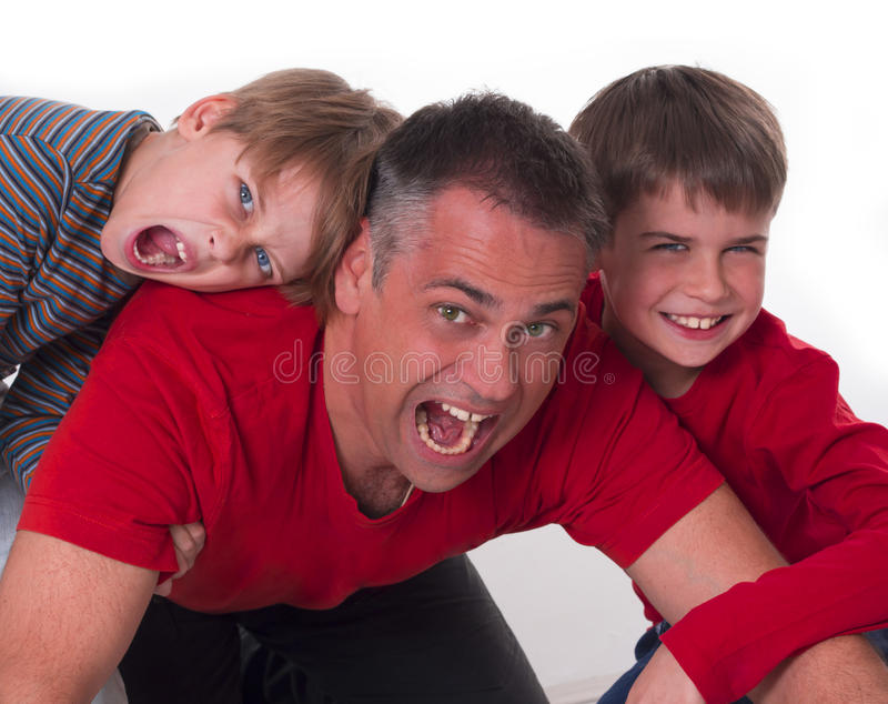 Spoiled children on their fathers back stock images
