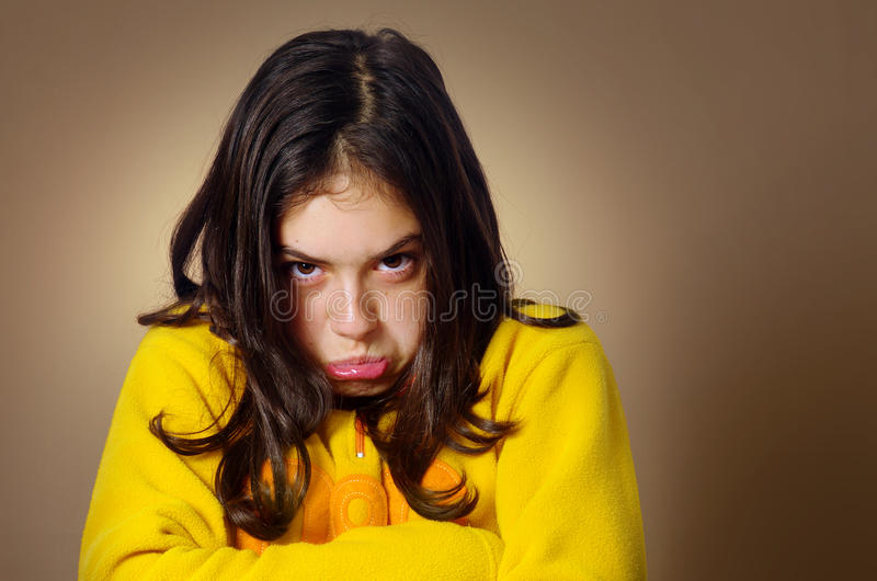 Stubborn Girl. Spoiled young girl with pouty expression and being very stubborn stock photography