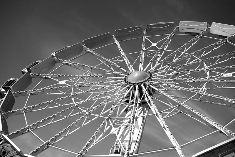 Spoke structure of a Ferris wheel. A black and white image of a Ferris wheel make the mechanical hub and support structures easier to study stock image