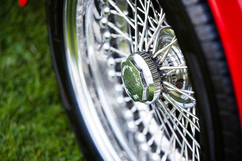 Spoked shiny wheel in classic car stock photography