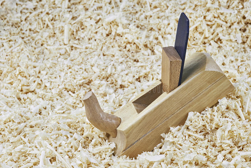 Spokeshave. One wooden spokeshave lying on wooden shavings stock image