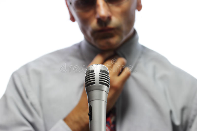 Spokesman. Microphone and out of focus Public speaker royalty free stock photo