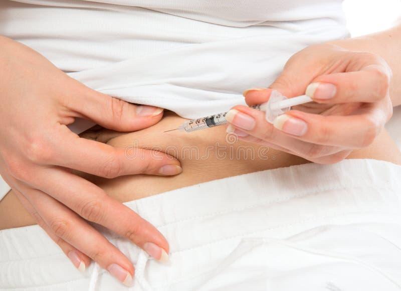Spola ren med dosen av lantusen, subkutan magevaccinering arkivfoto
