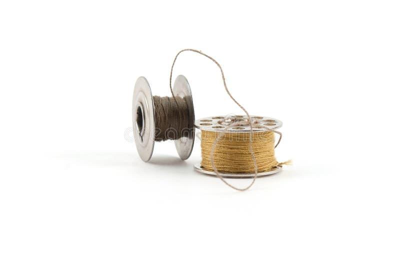 Spolar av tråden arkivfoton