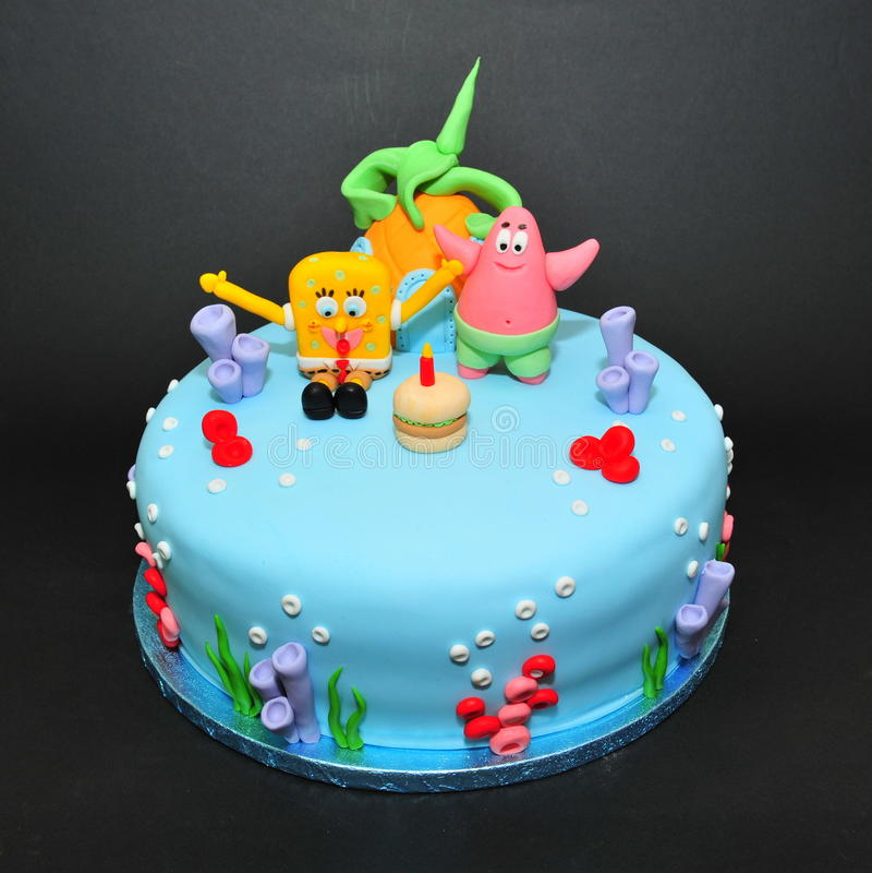 Sponge Bob cake. Cartoon characters theme cake for birthdays stock image