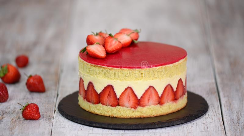 Sponge cake with strawberries and vanilla cream. Strawberry Fraisier cake royalty free stock photos
