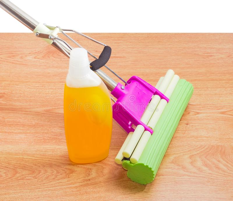 Sponge mop and floor cleaner on a wooden floor royalty free stock photos