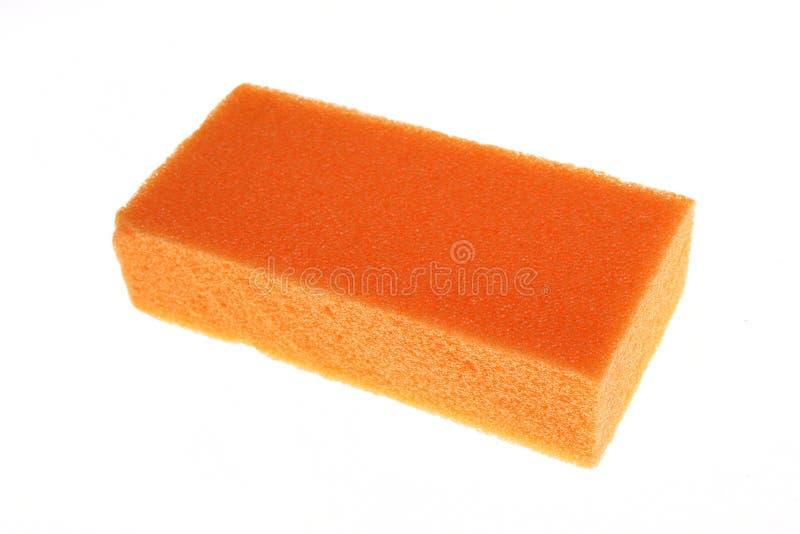 Sponge orange isolated. Sponge orange for washing dishes on the white background royalty free stock photography