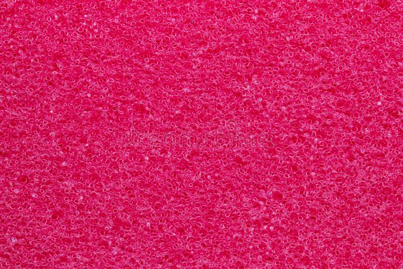 Sponge texture background. Close-up of red bath sponge texture with porous structure for background. Macro royalty free stock photos