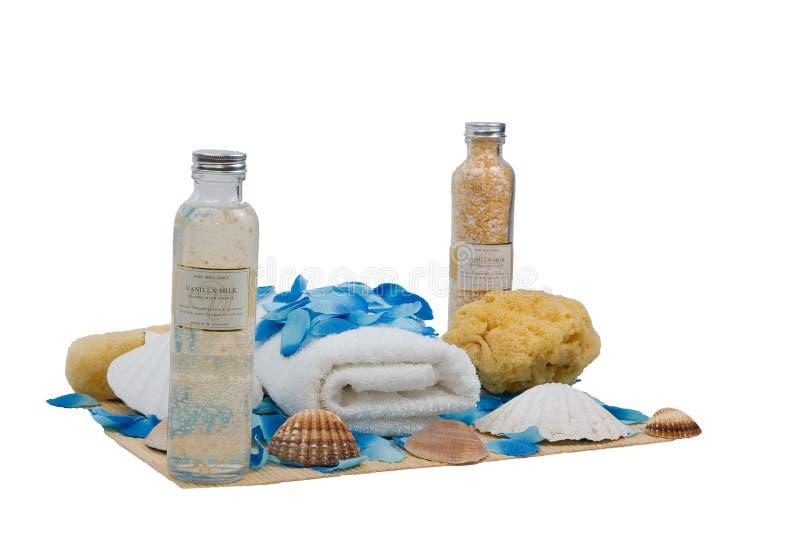 Sponge and towel - wellness set. Sponge and towel with seashell and petal - perfect wellness set stock image