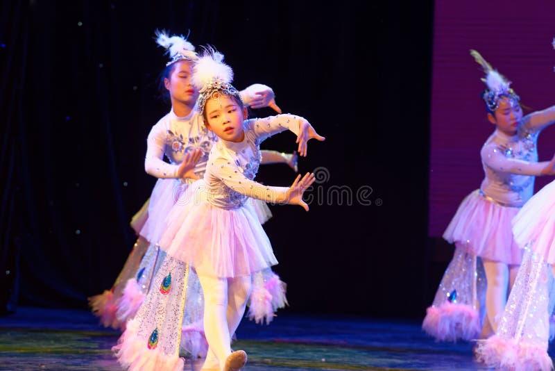 White Peacock- Beijing Dance Academy grading test outstanding children`s dance teaching achievement exhibition Jiangxi. Sponsored by the Beijing Dance Academy royalty free stock image
