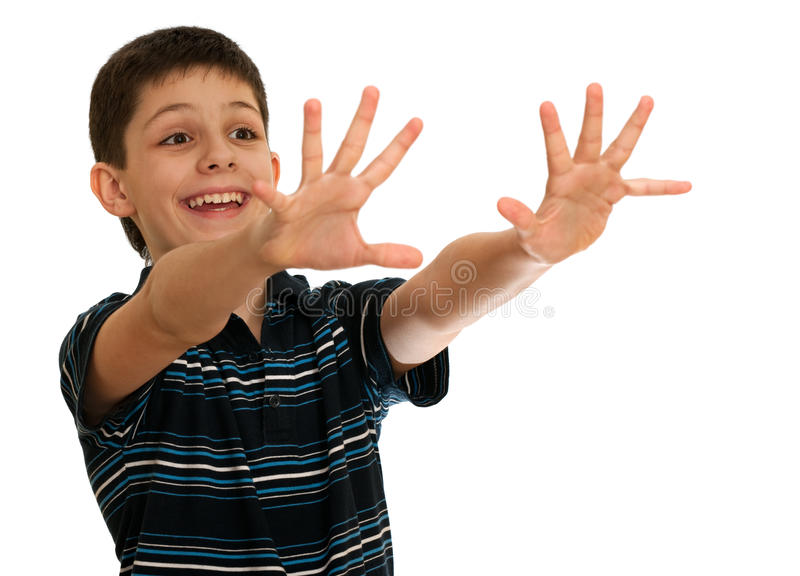 Spontaneous boy is stretching his hands towards royalty free stock photos
