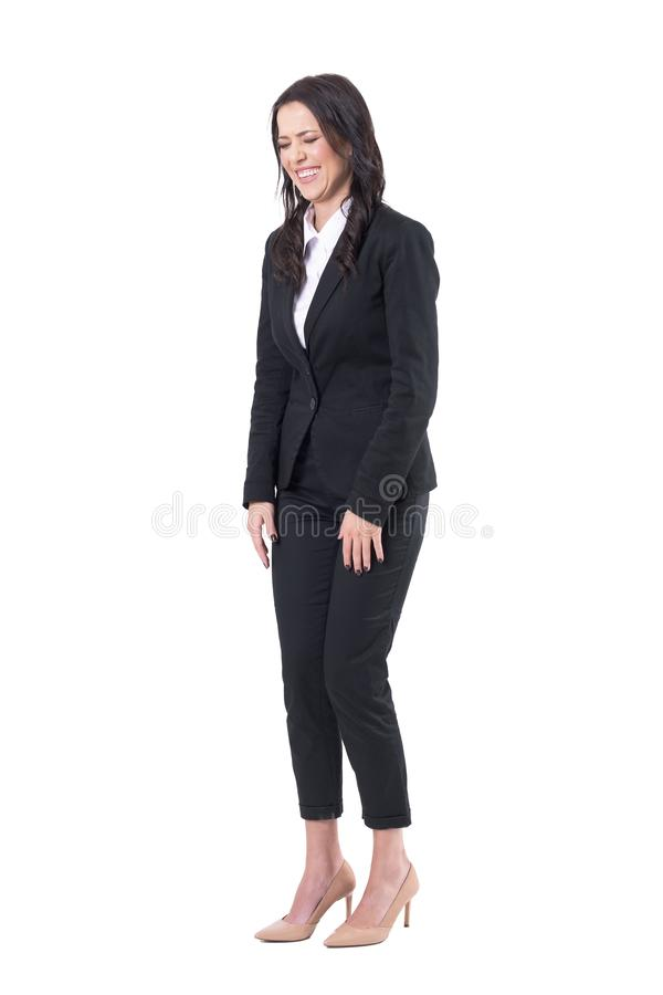 Spontaneous candid business woman in formal suit laughing with closed eyes stock image