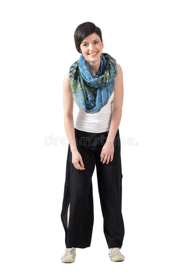 Spontaneous carefree smiling and looking at camera leaning forward stock photography