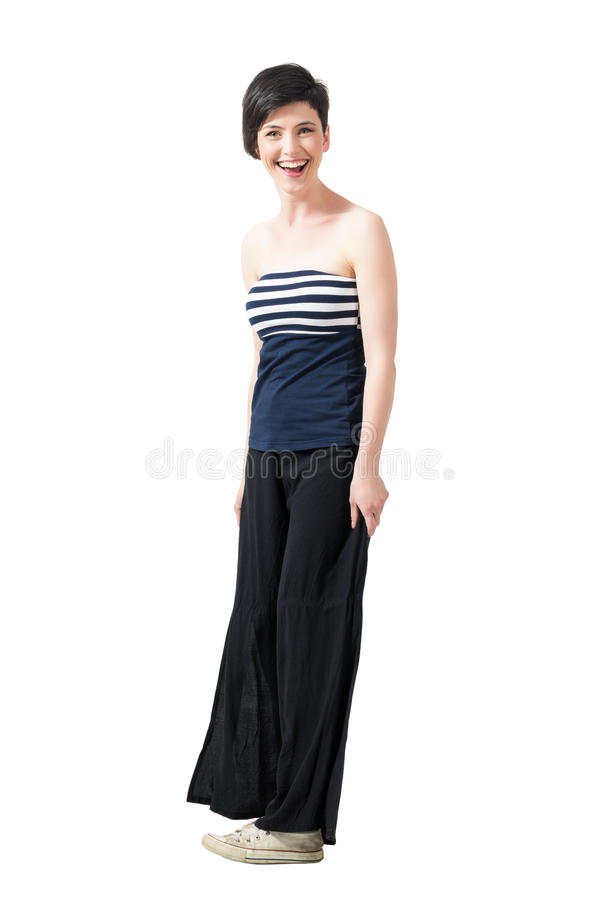 Spontaneously laughing short hair pretty woman looking at camera royalty free stock images