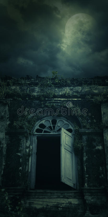 Spooky ancient window building with full moon, Halloween backgro. Und stock photos