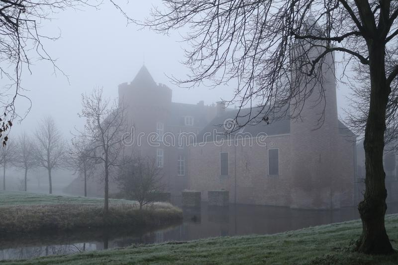 Spooky Castle in the mist stock photo