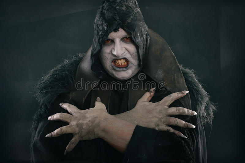 Spooky devil vamp with large scary nails. Hell and horror royalty free stock images