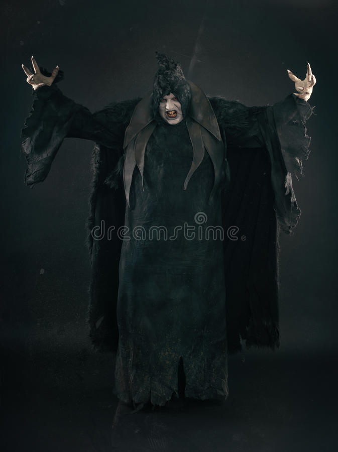 Spooky devil vamp with large scary nails. Hell and horror stock images