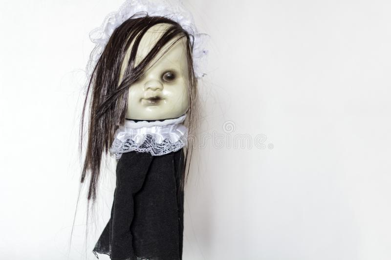 Spooky doll on white background with copy space. Halloween concept royalty free stock image