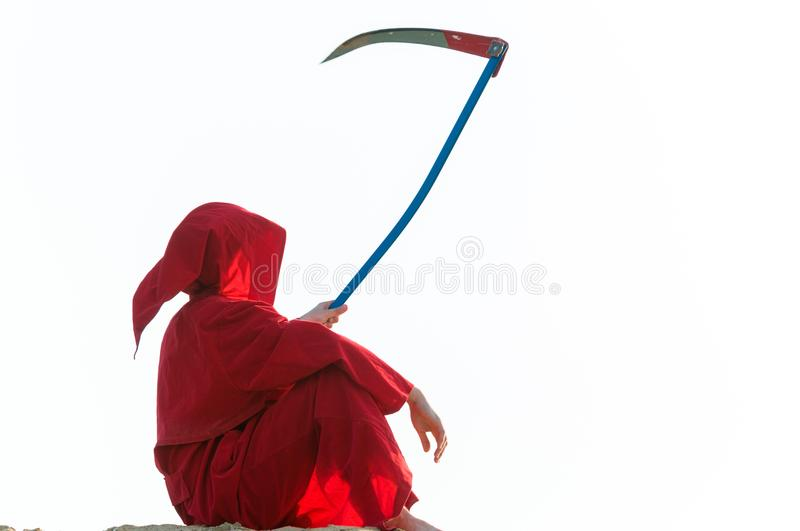 Grim reaper in red stock photography