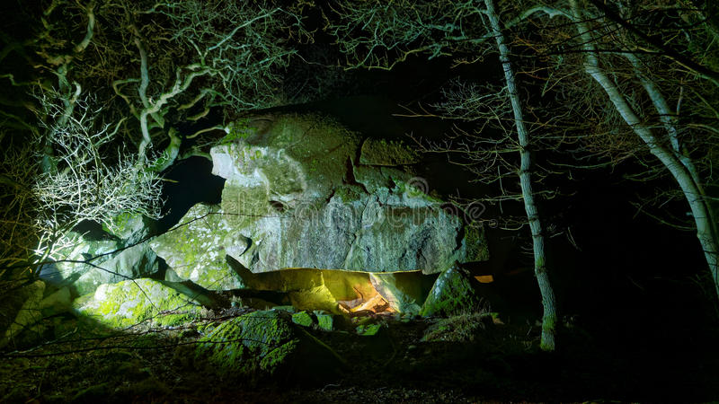 Spooky forest cave on danish island of Bornholm. The spooky forest cave called Elves' Hill, a natural cave in the 'troll forest' on the danish island of Bornholm royalty free stock photos