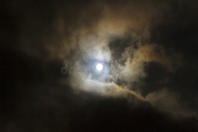 Spooky full moon eerie night sky with clouds stock image