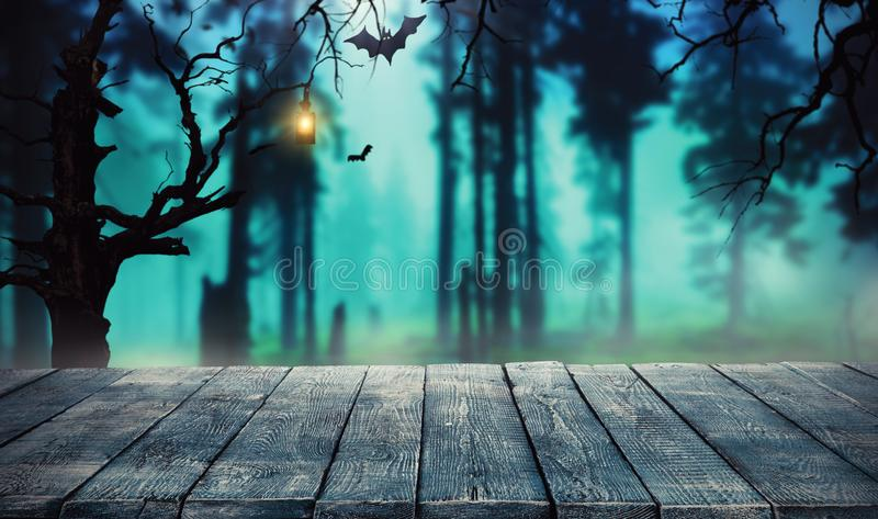 Spooky halloween background with empty wooden planks. Dark horror background. Celebration theme, copyspace for text. Ideal for product placement royalty free stock photo