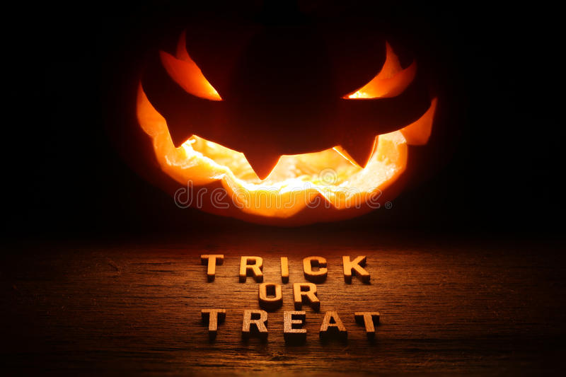 Spooky Halloween background with jack o lantern. Trick or Treat stock photos