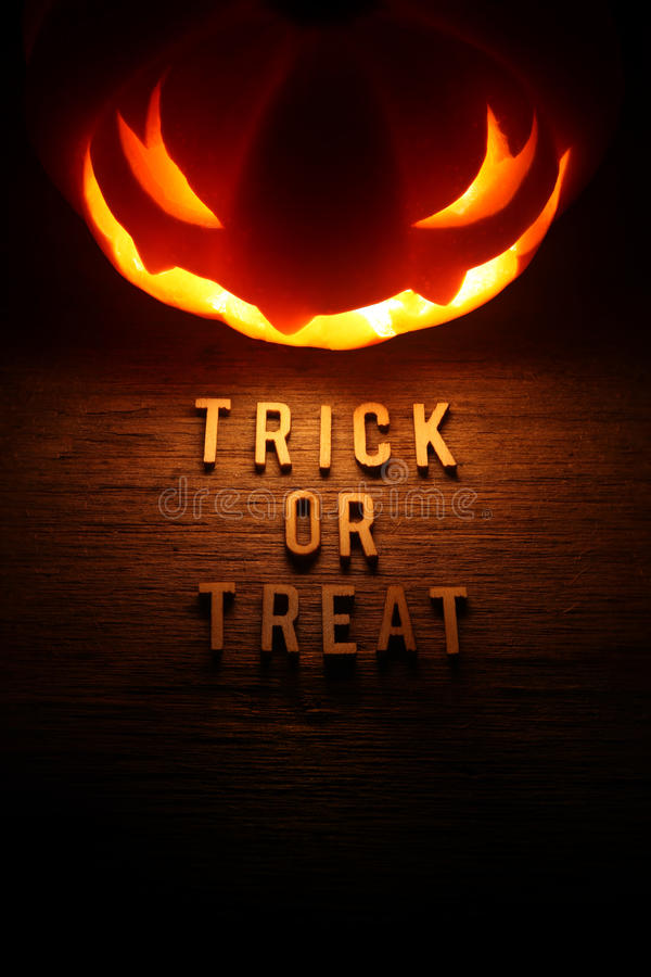 Spooky Halloween background with jack o lantern. Trick or Treat stock photography