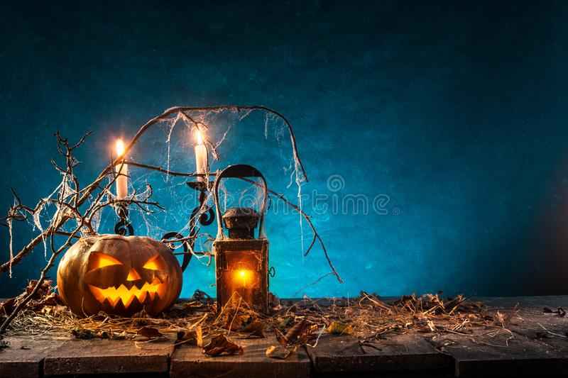 Spooky Halloween background. Spooky Halloween pumpkins on wooden planks with spooky background stock photo